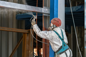 Applying-an-aerosol-coating-to-metal.