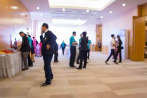 Abstract people walking in exhibition blurred background.jpg
