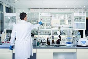 clean modern white medical or chemical laboratory. male chemist..jpg
