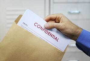 confidential-information-letter-hand.jpg