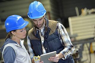Engineers in steel factory working on digital tablet-1