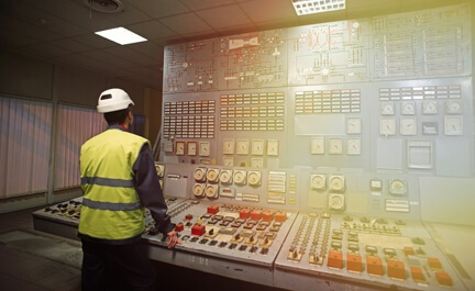 An energy management employee tracks utility usage and consumption.