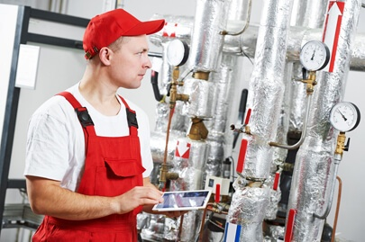 Inspection occurs while an industrial worker tracks and manages his EHS tasks.