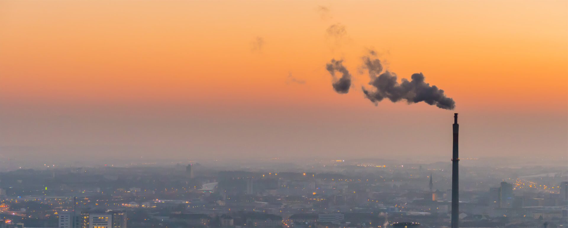 An emissions stack polluting hazardous chemicals and greenhouse gasses into the environment.